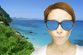 Redhead woman with sunglasses water reflection