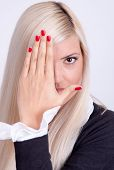 Beautiful Young Woman Hiding His Face With Hands