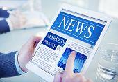 Hands Holding Digital Tablet Market and Finance News