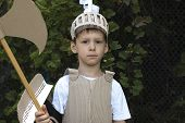stock photo of knights  - photo of the boy in medieval knight costume made of cardboards - JPG