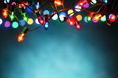 stock photo of blue  - Christmas lights over dark blue background - JPG