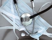 Surgical Mask And A Stethoscope. The Symbols Of Medicine.