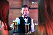 picture of bartender  - Freshly tapped beer - JPG