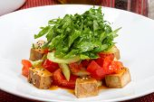 Fresh Vitamin Salad Of Feta, Tomatoes, Arugula Leaves And Sesame Seeds