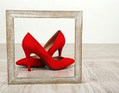 Red women shoes with frame on floor