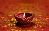 pic of diwali lamp  - A decorative Diwali lamp against glittering background - JPG