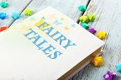 Fairy tales on wooden table, close-up