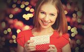 Beauty Girl In Red Dress With Gift Box To Christmas Or Valentine's Day