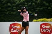 KUALA LUMPUR, MALAYSIA - OCTOBER 11, 2014: Moriya Jutanugarn of Thailand tees off at the second hole of the KL Golf & Country Club during the 2014 Sime Darby LPGA Malaysia got tournament.