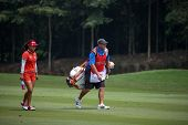 KUALA LUMPUR, MALAYSIA - OCTOBER 10, 2014: Jenny Shin of the USA walks on the fairway of the ninth hole of the KL Golf & Country Club at the 2014 Sime Darby LPGA Malaysia golf tournament.