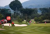 KUALA LUMPUR, MALAYSIA - OCTOBER 11, 2014: Golf fans and locals follow the leaders' flight at the fourth hole of the KL Golf & Country Club during the 2014 Sime Darby LPGA Malaysia golf tournament.