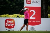 KUALA LUMPUR, MALAYSIA - OCTOBER 11, 2014: Marina Alex of the USA tees off at the second hole of the KL Golf & Country Club during the 2014 Sime Darby LPGA Malaysia golf tournament.
