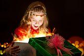 Emotional Girl Opening Christmas Present.