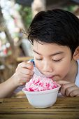 Little Asian Child With Ice Cream