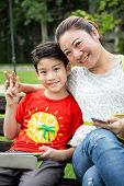 Beautiful Asian Woman With Your Son In The Park
