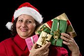 Mature Lady Holding Up Five Christmas Presents.