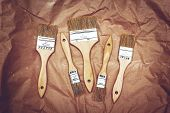 Set Of Five Renovation Brushes On Craft Paper