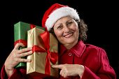 Aged Woman Pointing At Two Gifts, Golden And Green.
