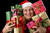 Cheerful Female Senior Embosoming Wrapped Gifts.