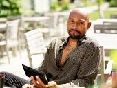 portrait of happy mature african man with smart phone