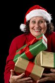 Cheerful Old Lady Offering Three Wrapped Gifts .