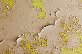 Old Cracked And Abandoned Yellow Wall
