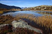 Beautiful autumn scenery with a lake in the Norwegian mountains, Oppland County, on a sunny day