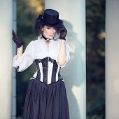 Mysterious woman in Victorian dress
