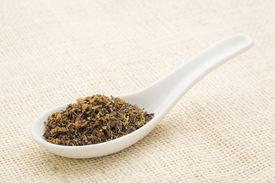 stock photo of irish moss  - Irish moss seaweed on a white Chinese spoon against burlap canvas - JPG