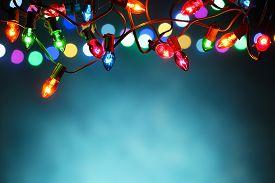 foto of glitter sparkle  - Christmas lights over dark blue background - JPG