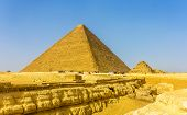 stock photo of the great pyramids  - The Great Pyramid of Giza and smaller Pyramid of Henutsen  - JPG