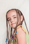 stock photo of dreadlocks  - Young girl with dreadlocks and yellow blouse - JPG