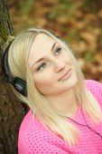 Young girl listening to music with headphones