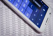 Smartphone Calculator Next To Financial Documents