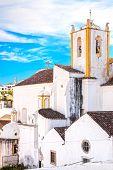Church And White Facades Old Village Tavira In Alentejo, Portugal