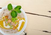 pic of chickpea  - Hearty Middle Eastern Chickpea and Barley Soup with mint leaves on top - JPG