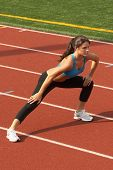 Young Woman in Sports Bra Doing Leg Lunge