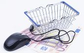 Shopping basket with cash and mouse