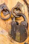 Closeup Of An Old Rusty Lock On The Wooden Door