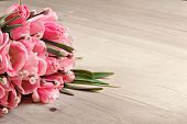 Bouquet Of Pink Fresh Tulips On Wooden Background