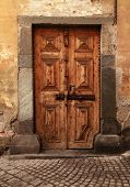 Vintage Brown Wood Medieval Door In Rural Stone House