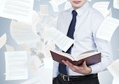 Businessman Holding Book