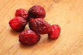 stock photo of dry fruit  - Healthy high fiber food organic nutrition. Close up dried cranberries cranberry fruit on wooden table