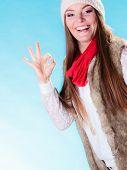 Woman In Winter Clothing Ok Gesture