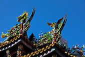 Colorful carvings on roof of Japanese temple