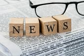 News Text On Wooden Blocks With Eyeglasses