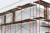 pic of reconstruction  - Plaster wall of building under reconstruction with scaffolding - JPG