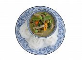 Thai Green Curry Pork And Rice Noodles Served On Dish With White Background
