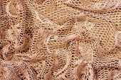 stock photo of rayon  - Golden Color Background Made with Folded Lacy Fabric - JPG