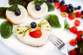 Cheesecakes as animal face with fresh berries, toned